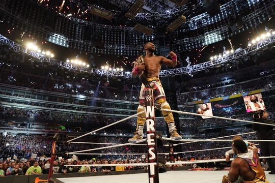 Kofi Kingston poses with the WWE Championship after winning the title match at WrestleMania 35 at MetLife Stadium.