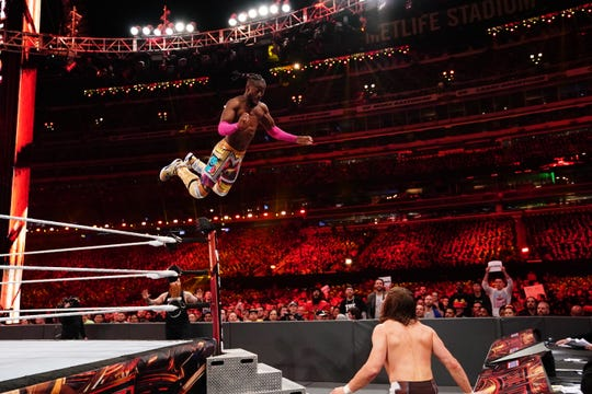 Kofi Kingston jumps from the top turnbuckle toward Daniel Bryan during the WWE Championship match at WrestleMania 35 at MetLife Stadium.