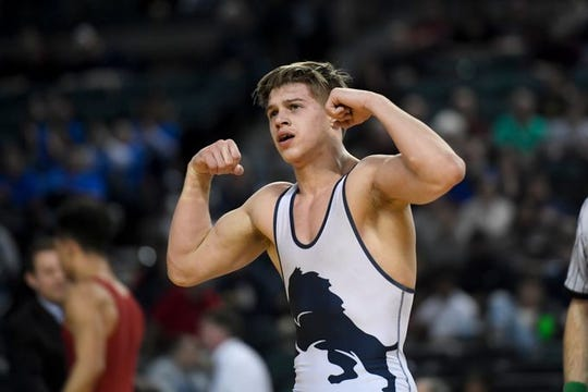 Pope John's Joseph Aragona flexes his muscles after winning the NJSIAA 138-pound championship in March