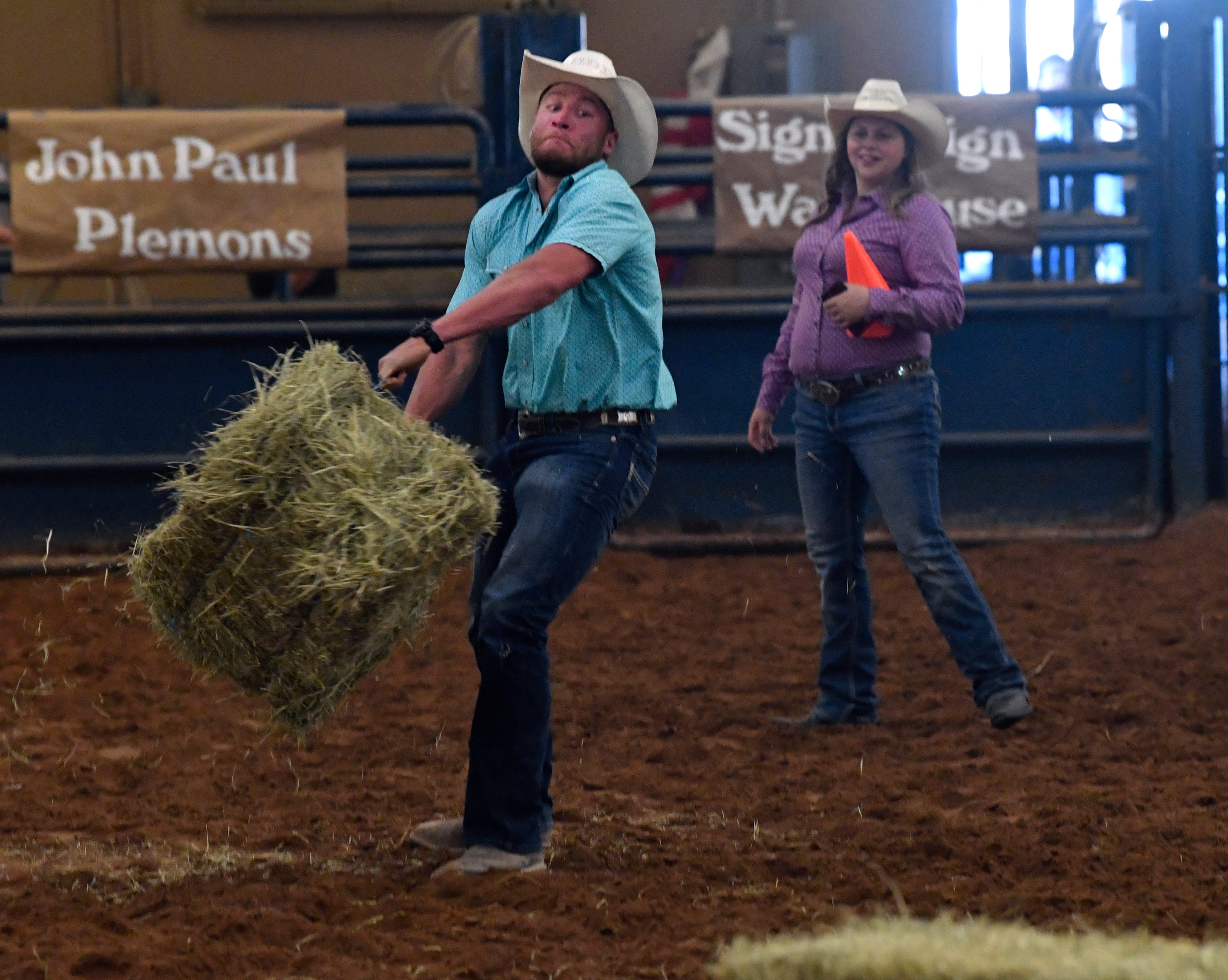Hunter Gibson swings a hay bale around during the hay bale toss. This was the 64th year for the rodeo which was held at the Taylor County Expo Center.