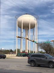 Cabling hangs from the elevated water tank at Buffalo Gap Road on Saturday.