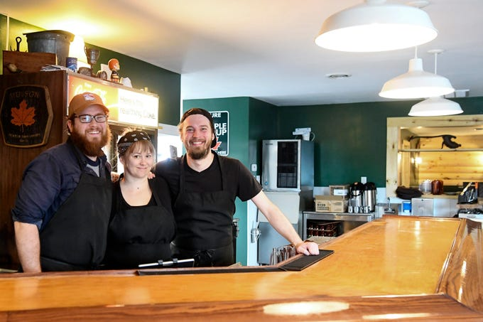 From left, chef and owner of Sawhorse, Dan Silo, pastry chef Emily Cadmus and sous chef Zachary Stinson stand behind the bar at the new restaurant April 8, 2019.