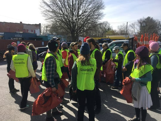 Some 75 volunteers came together with the West Asheville Business Association, Asheville GreenWorks and other sponsors March 31 to clean up trash from Haywood Road.