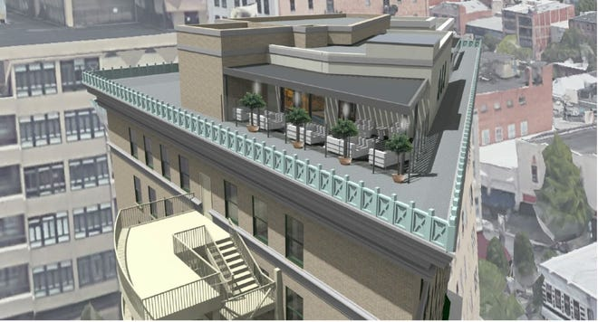 A rendering of downtown Asheville's Flatiron Building along Battery Park Avenue. Developers have proposed converting the 93-year-old property into an 80-room hotel.