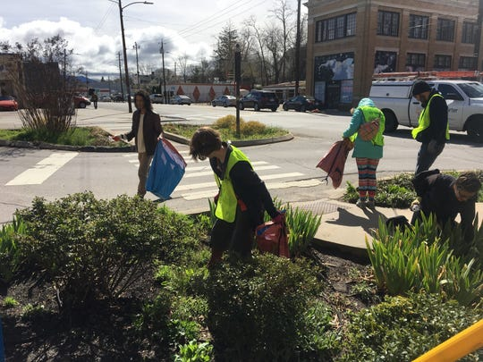 Some 75 volunteers came together with the West Asheville Business Association, Asheville GreenWorks and other sponsors March 31 to clean up trash from Haywood Road and kick off Earth Month.