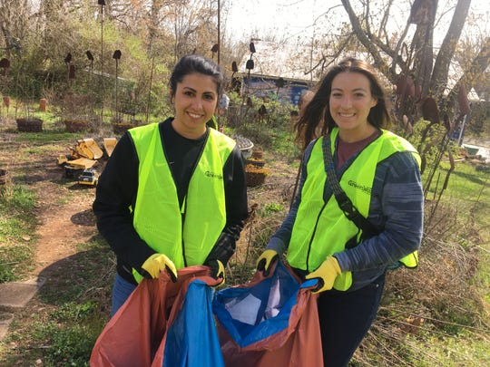Kelly Montague, left, and Sara Vincelli, of South Asheville, volunteered March 31 at the Haywood Road Clean Up Day with the West Asheville Business Association and Asheville GreenWorks.