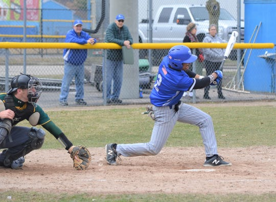 KCC's Trenton Newby takes a cut in a Bruins' win over Glen Oaks CC.