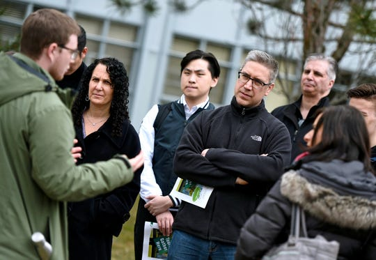 Binghamton University student Bradley Goldman, left, of Stony Point, leads a group tour for prospective students and parents during the Admitted Student Open House.
