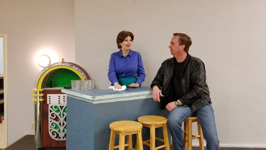 """Deidre and John Hemphill rehearse a scene from """"All Shook Up"""" in Paradise Theatre's rented performance space on Bay Street in Port Orchard."""