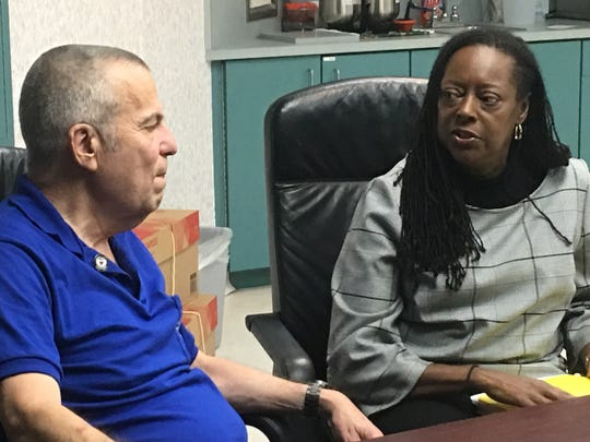 """Health First's Holmes Regional Medical Center Auxiliary President Allan Gair, left, chats with Marcia Phillips, Manager of Volunteer Services and Customer Experience. Phillips describes those who give their time to the organization as """"a phenomenal gift."""""""