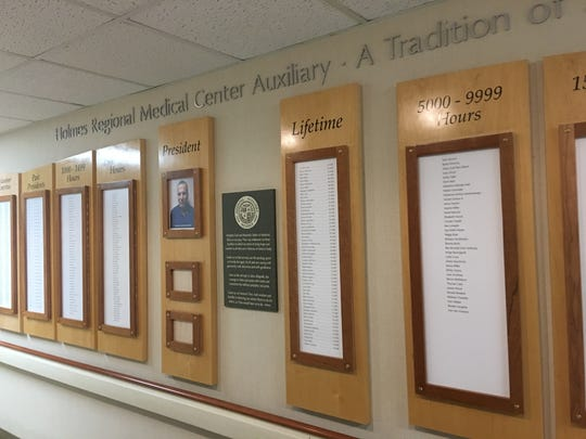 The Health First Holmes Regional Medical Center Auxiliary wall pays tribute to volunteers past and present.