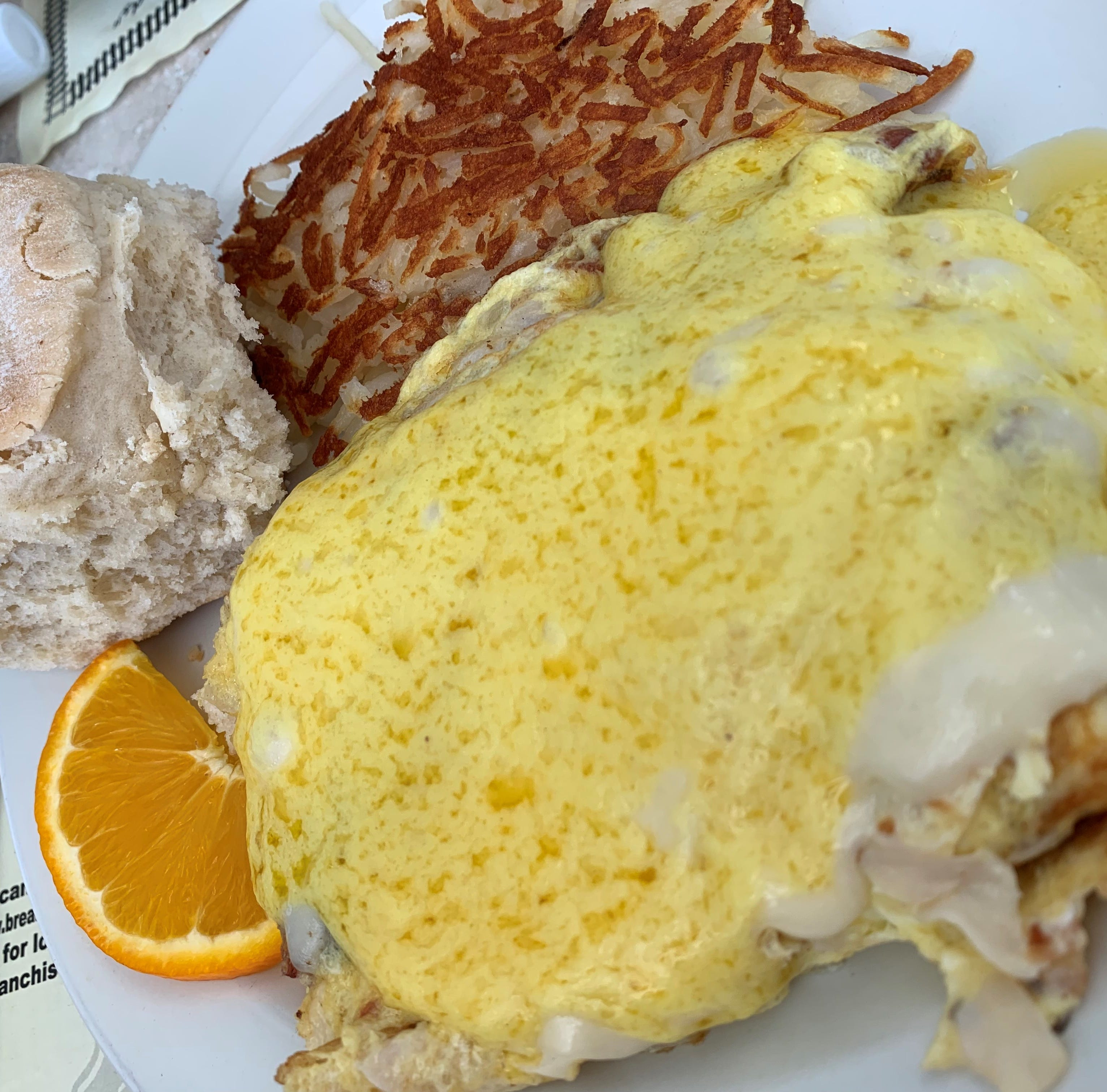 The Country Omelet at Breakfast Station was a thick, folded-over affair that contained lots of turkey and bacon, atop which was set a decent slice of Swiss cheese, under hot, bright yellow Hollandaise.