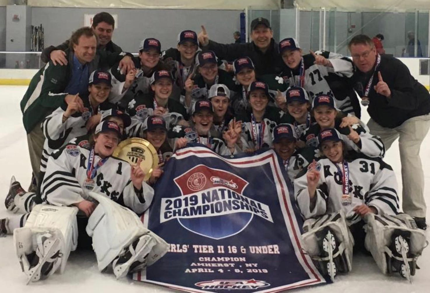 The 16U Vermont Shamrocks pose for a celebratory photo after winning the Tier II national championship in Amherst, New York, on Monday morning.