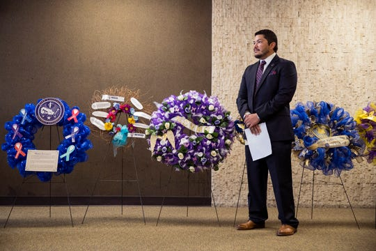 District Attorney Mark Gonzalez listens as agencies describe the services they provide during the National Crime Victims' Rights Week Wreath Ceremony at the Nueces County Courthouse on Monday, April 8, 2019.