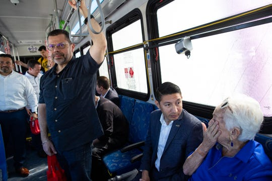 Corpus Christi City Council Member Roland Barrera (left) and Ben Molina ride a RTA bus along with other City Council members from the Staples Street Station to the Port Ayers Station on Monday, April 8, 2019.