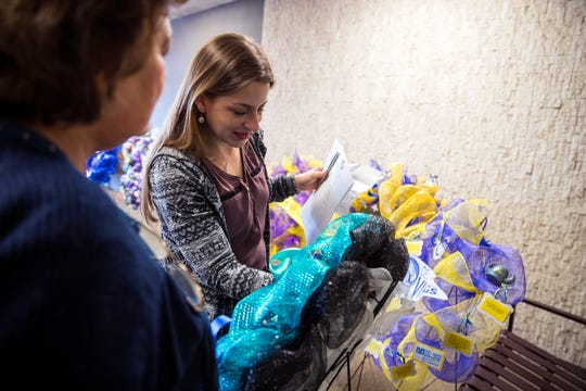 Pat Kapitan (left) gets help placing a wreath from Sharra Rodriguez, victim assistance coordinator with the Nueces County District Attorney's Office, during the National Crime Victims' Rights Week Wreath Ceremony at the Nueces County Courthouse on Monday, April 8, 2019.