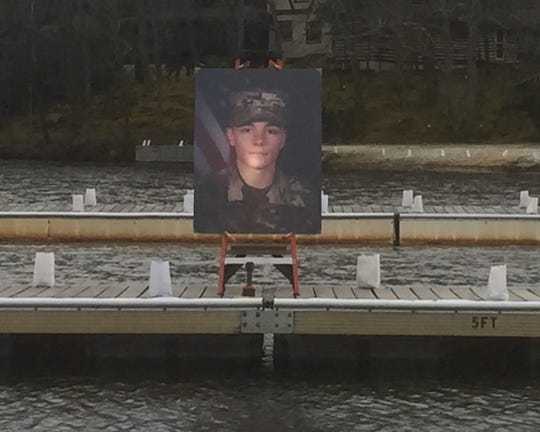 A photograph of Army Spc. Nicholas DiMona III appears on a dock in Lower Lake Aetna, Medford Lakes.