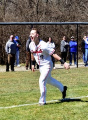 Colerain's Luke Murray is all smiles as he rounds third and heads to home after his game wining walkoff homerun at Colerain High School, March 23, 2019.