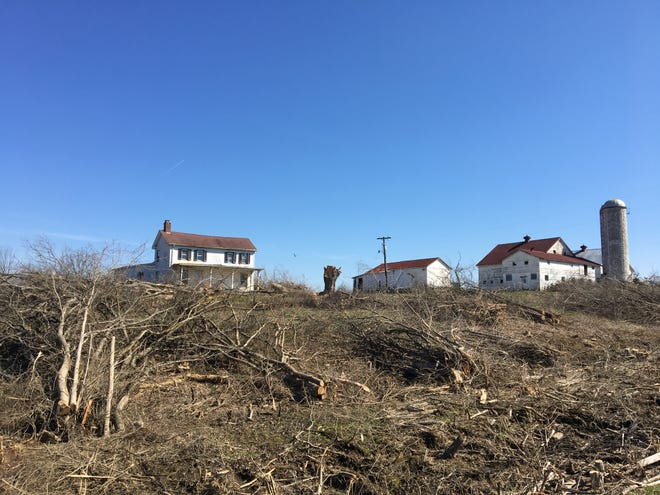 Trees and dirt have been removed near a farmhouse and barn on Limaburg Creek Road in Boone County in this file photo from 2019 of the Amazon Prime Air cargo hub construction site. A class-action complaint claiming the site is a nuisance, and seeking a jury demand, has been filed against Whiting-Turner/Kokosing Joint Venture, a partnership formed by contractors to build the Amazon cargo hub.