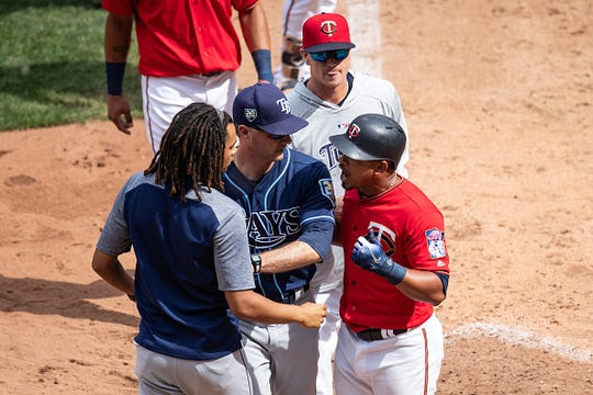 Eduardo Escobar #5 of the Minnesota Twins is separated from Chris Archer #22 of the Tampa Bay Rays on July 15, 2018 at Target Field in Minneapolis, Minnesota. The Twins defeated the Rays 11-7.