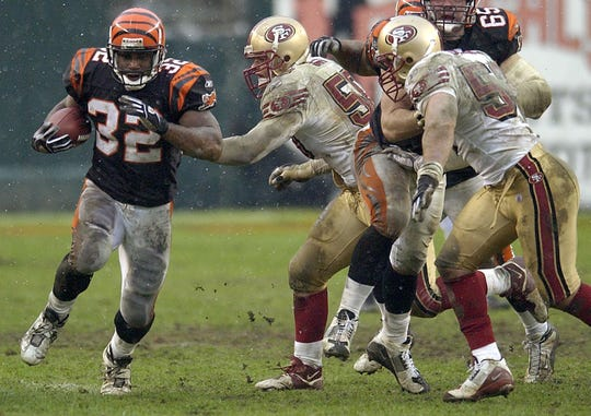 SUNDAY DECEMBER 14, 2003. The Cincinnati Bengals defeated theSan Fransisco 49ers 41-38 at Paul Brown Stadium. Rudi Johnson (32) rushed for 174 yards on 21 carries and two touchdowns in leading the Bengals offense. Cincinnati Enquirer/Michael E. Keating