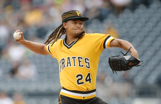 Pittsburgh Pirates starting pitcher Chris Archer (24) delivers a pitch against the Cincinnati Reds during the first inning at PNC Park on April 7.