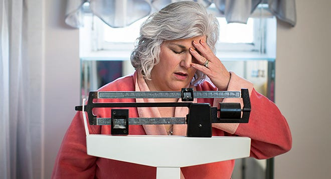 A weight plateau happens because as you lose weight, your basal metabolic rate decreases.