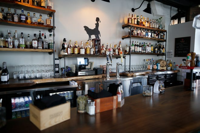 The well-stocked bar featuring dozens of whiskies and bourbons at Libby's Southern Comfort in Covington, Ky., on Monday, April 8, 2019.