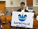 Patrick Pusung displays new logo at the Sayreville Borough Council meeting on Monday, March 25.