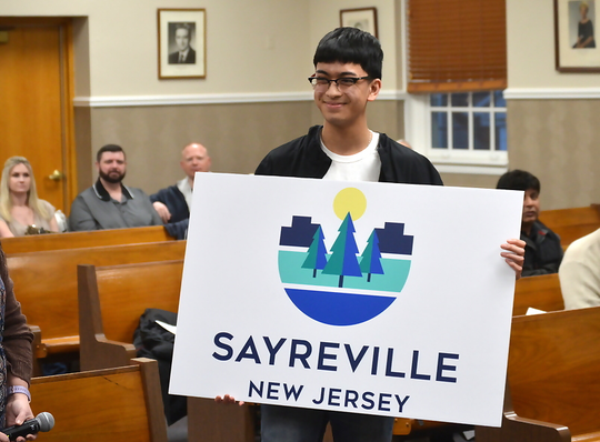 Patrick Pusung displays new logo at the Sayreville Borough Council meeting on Monday, March 25.