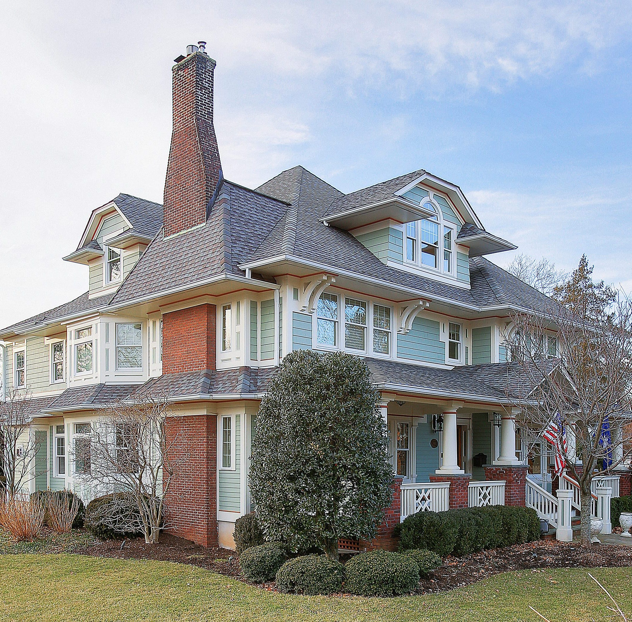Custom Colonial occupies corner lot with in-ground pool and waterfalls