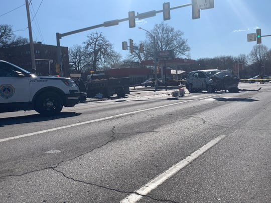 A damaged SUV, right, and truck parked Monday, April 8, 2019, at the intersection of 31st Street and University Avenue. The SUV, which was stolen, hit the truck, police say.  The truck driver was not injured, but one of the juveniles in the SUV suffered serious injuries, police say.