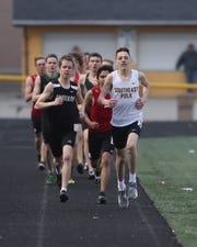 Drake Hanson leads the pack in the 1,600-meter run during the Ram Relays on April 4 at Southeast Polk High School.