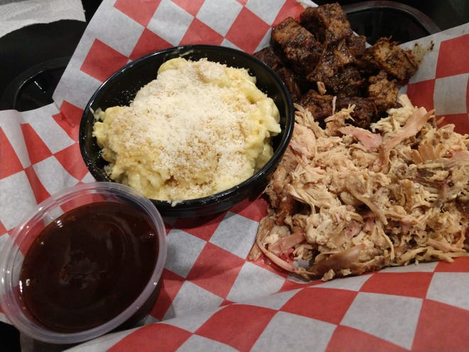 The barbecue chicken, burnt ends and macaroni and cheese at Rolling Smoke Barbeque in Pleasant Hill.