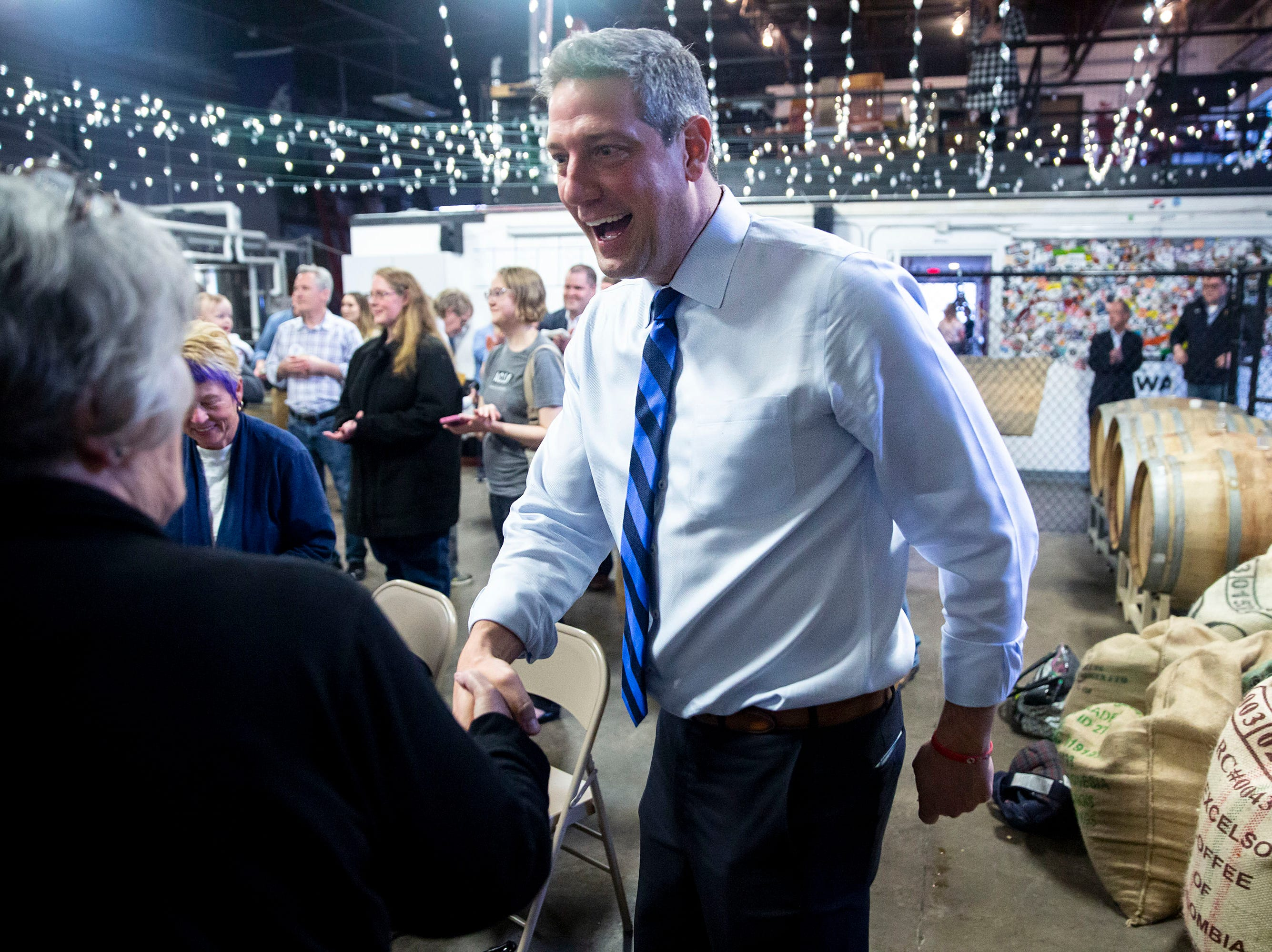 U.S. Rep. Tim Ryan, D-Ohio, shakes hands with people at a meet and greet event organized by the Polk County Democrats on Sunday, April 7, 2019, at Fox Brewing in West Des Moines. This is Ryan's first visit to Iowa after announcing he's running for president.