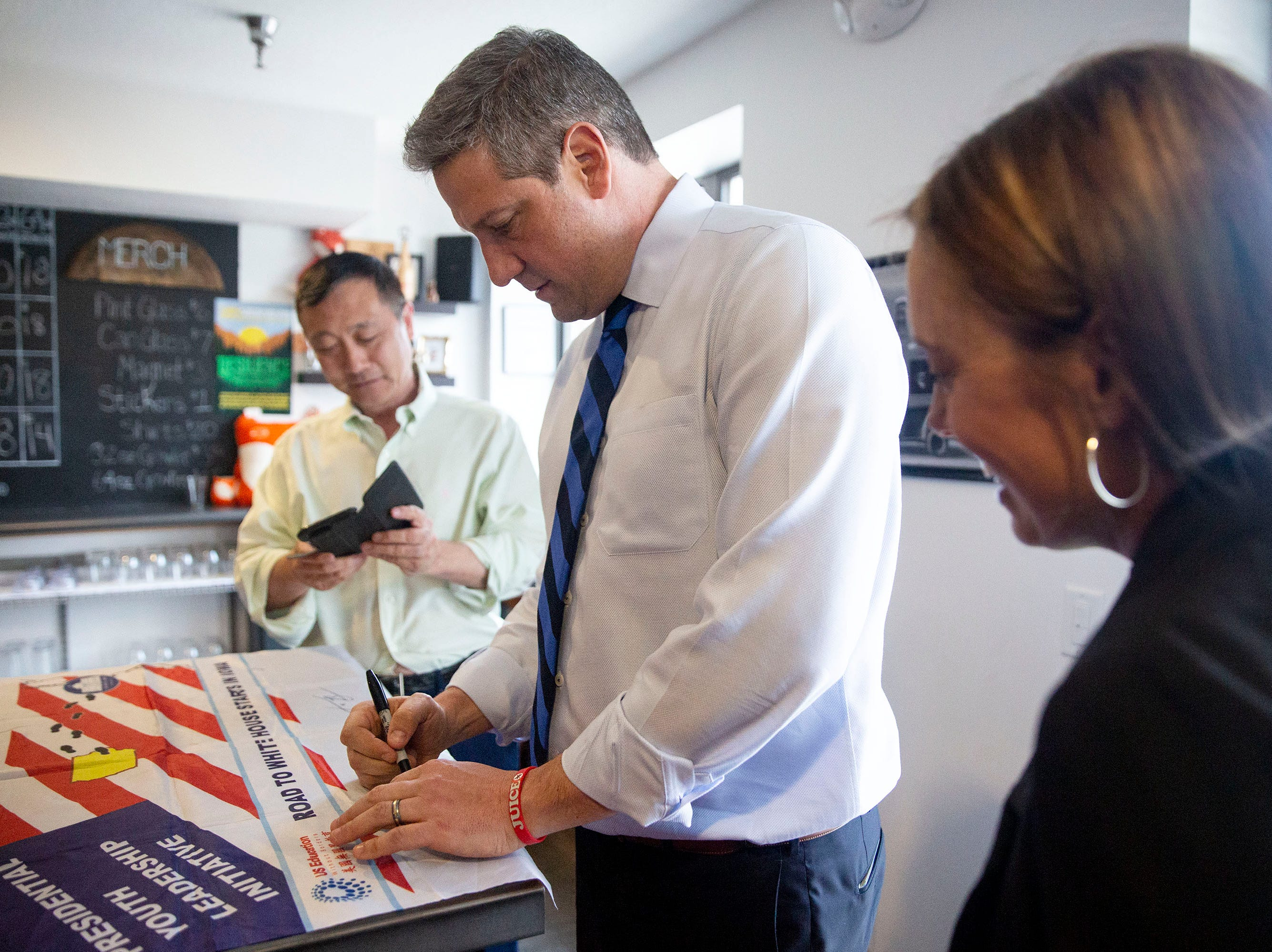 U.S. Rep. Tim Ryan, D-Ohio, signs his autograph before a meet and greet event organized by the Polk County Democrats on Sunday, April 7, 2019, at Fox Brewing in West Des Moines. This is Ryan's first visit to Iowa after announcing he's running for president.