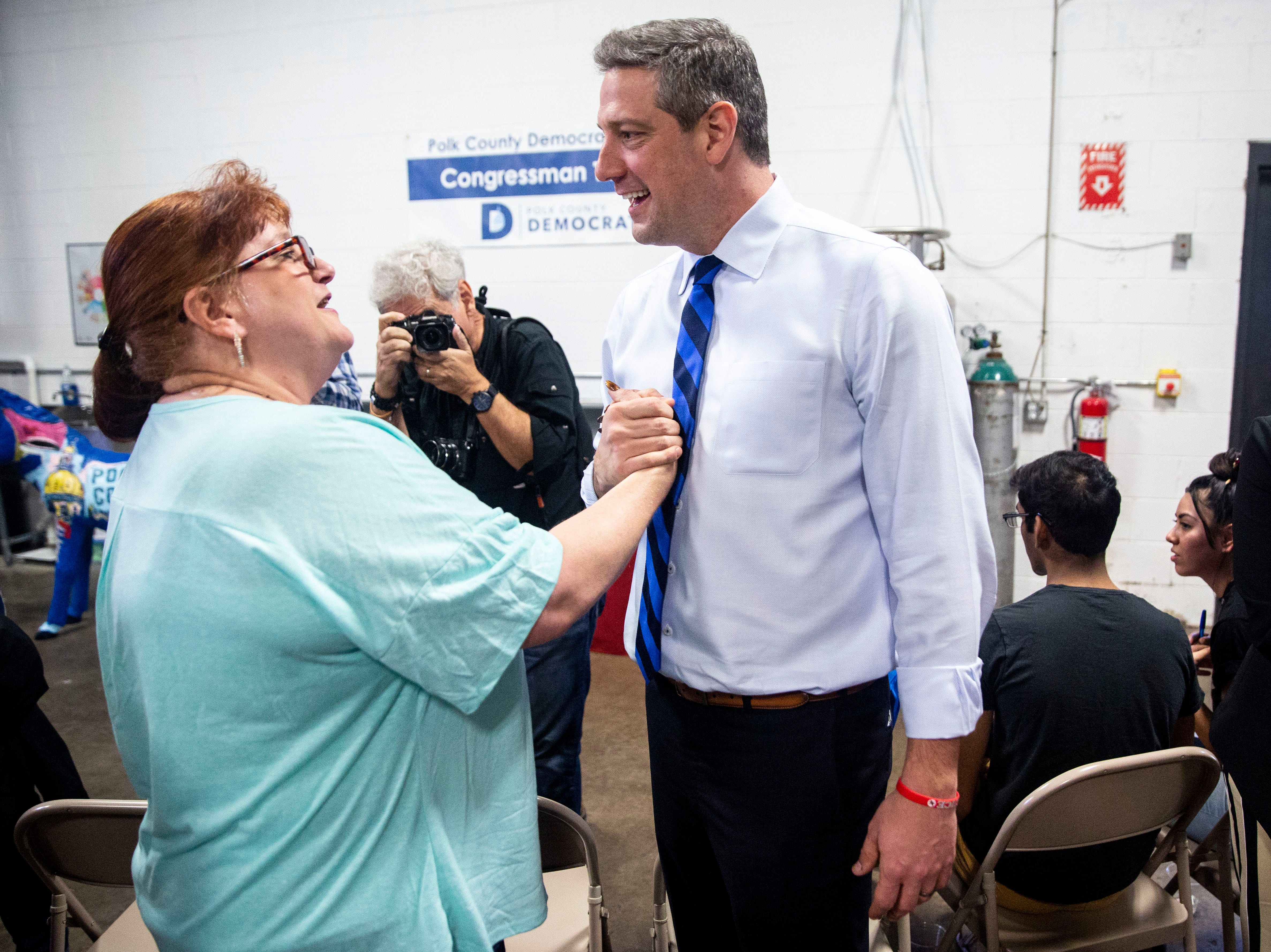 U.S. Rep. Tim Ryan, D-Ohio, shakes hands with Tamyra Harrison, of Mitchellville, at a meet and greet event organized by the Polk County Democrats on Sunday, April 7, 2019, at Fox Brewing in West Des Moines. This is Ryan's first visit to Iowa after announcing he's running for president.