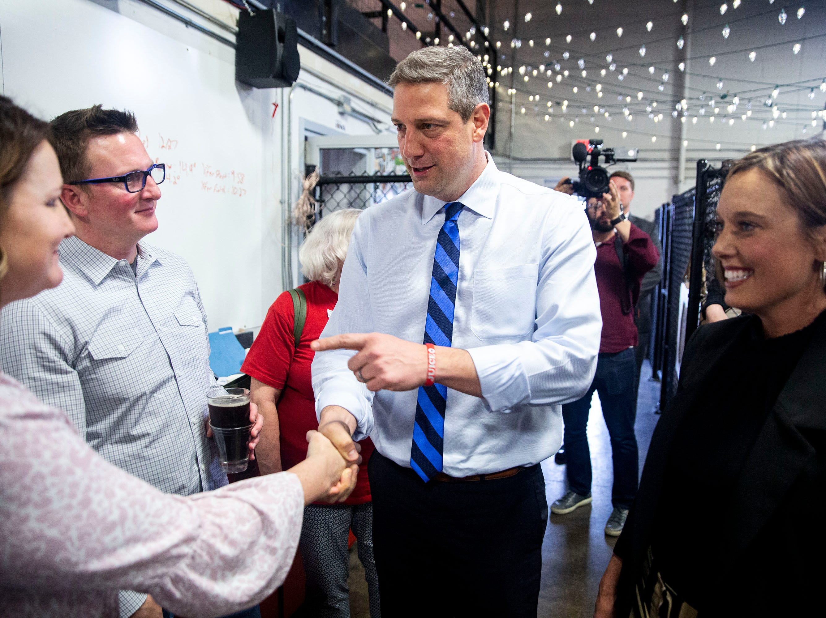 U.S. Rep. Tim Ryan, D-Ohio, and his wife, Andrea Zetts, shakes hands with people at a meet and greet event organized by the Polk County Democrats on Sunday, April 7, 2019, at Fox Brewing in West Des Moines. This is Ryan's first visit to Iowa after announcing he's running for president.