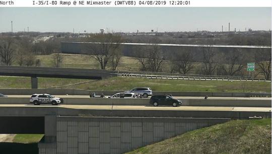Police investigate a crash Monday, April 8, 2019, near the east mixmaster in Des Moines, Iowa.