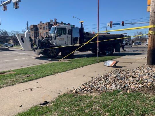 A damaged truck parked Monday, April 8, 2019, at the intersection of 31st Street and University Avenue. A stolen SUV hit the truck, police say. One of the four people involved were seriously injured.