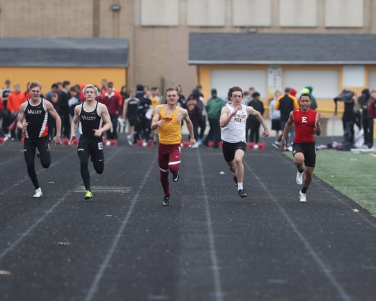 Southeast Polk's Mason Whitlatch runs the 100-meter dash April 4 at the Ram Relays.