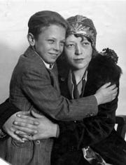 Iowa runaway Arthur Hutchins Jr., pretends to be the missing son of Christine Collins, right, in this 1928 photo. Collins did not believe Hutchins was her missing son, but Los Angeles police forced her to take the boy home for five weeks. The hoax was eventually uncovered, though Collins never found her missing son, Walter.