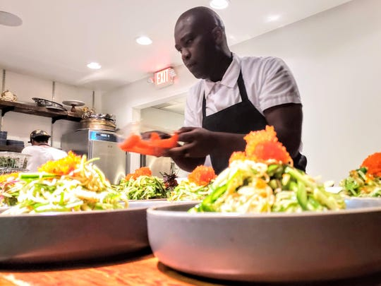 Adachi and Zao Jun Executive Chef Lloyd Roberts plates a salad during a special dinner at Frame in Hazel Park on October 24, 2018.
