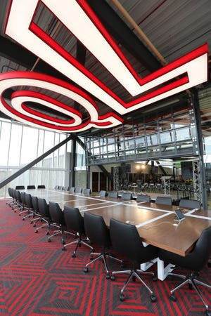 Large conference room surrounded by glass windows at the new Quicken Loans Technology Center in Corktown, Detroit on Tuesday, June 30, 2015.