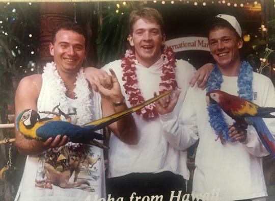 Out of his Sparty costume, Dave Russell poses with his Spartan football roommates during the 1989 Aloha Bowl. Pictured left to right: Dave Russell, MSU punter Josh Butland, MSU kicker John Langloh.
