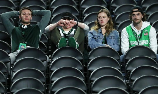 Michigan State fans sit in the stands following the Spartan's loss to Texas Tech in the Final Four at U.S. Bank Stadium in Minneapolis, Minnesota on Saturday, April 06, 2019.