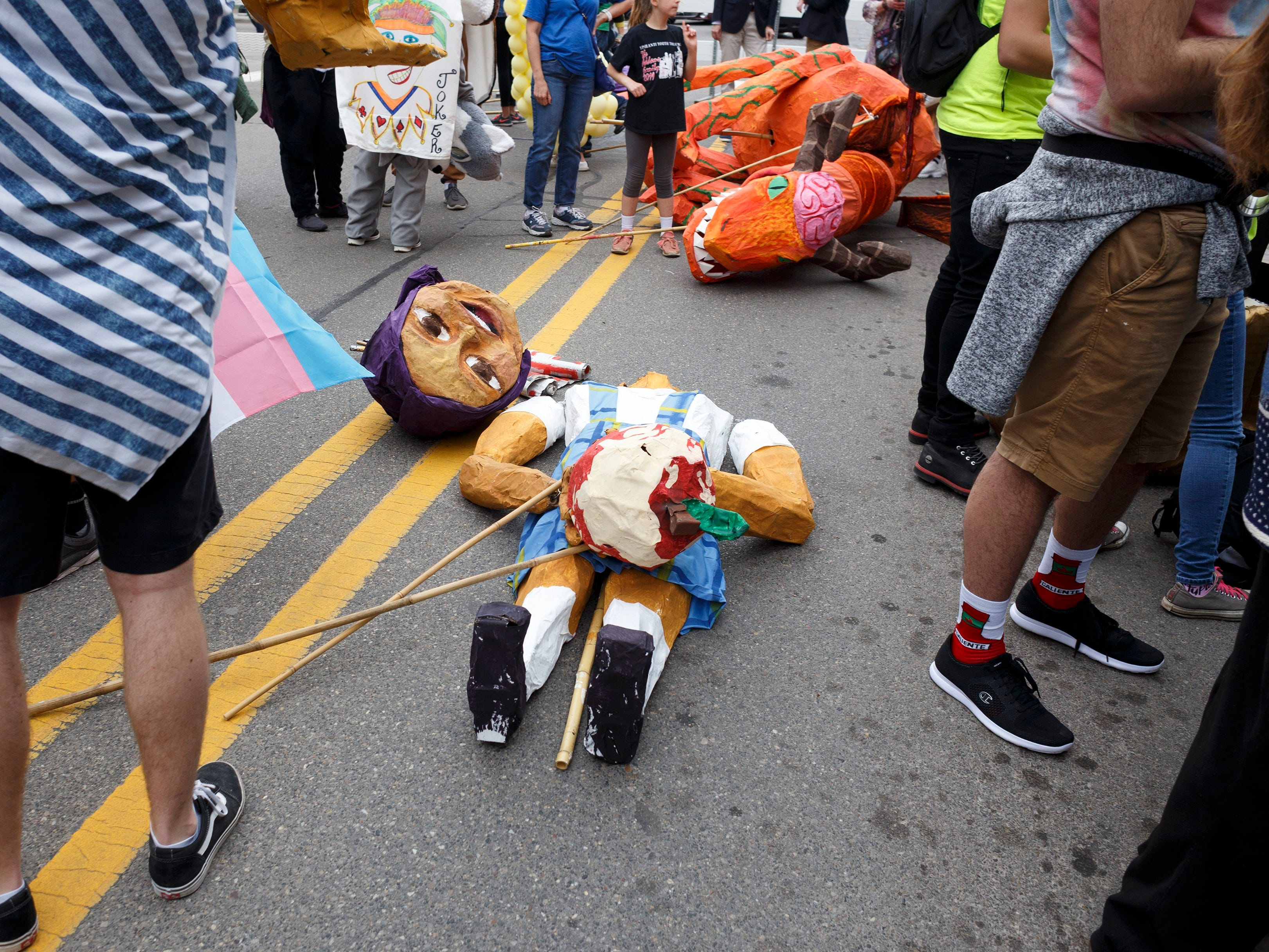 Puppets and people take a moment before the start of the annual FestiFools parade on Sunday, April 7, 2019 on South Main Street in downtown Ann Arbor.