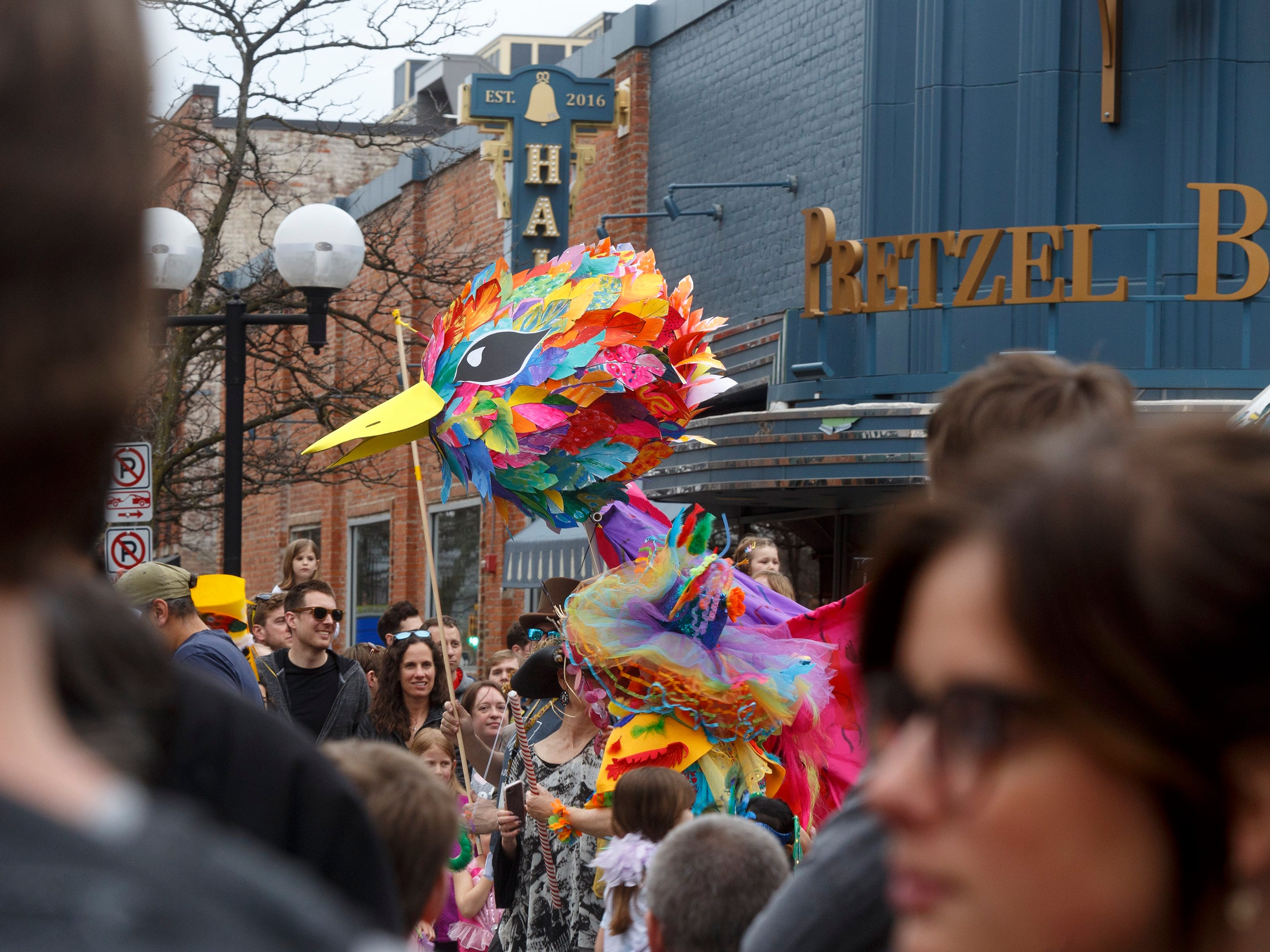 Puppets take over South Main Street during the annual FestiFools parade on Sunday, April 7, 2019 in downtown Ann Arbor.
