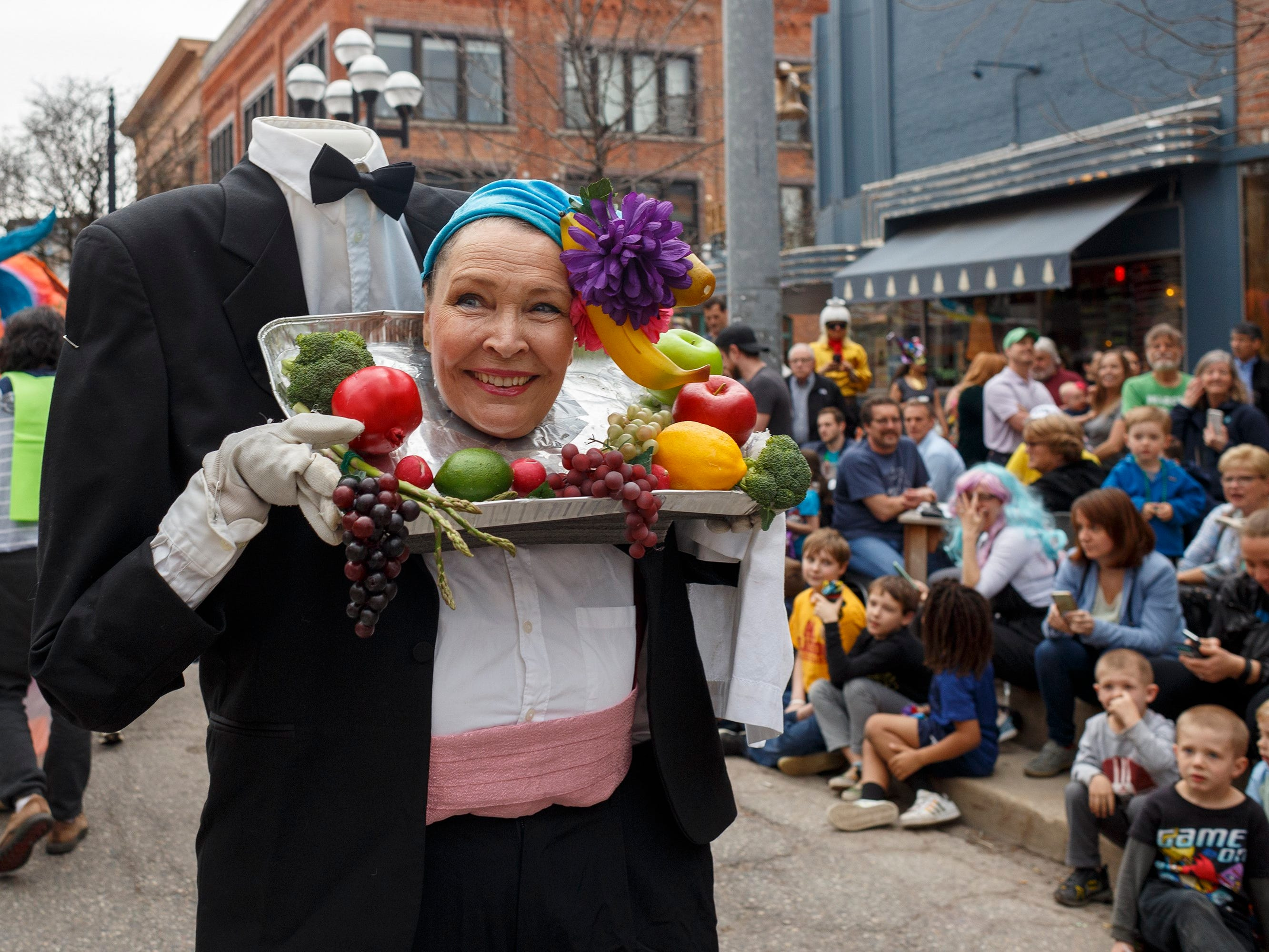 Carol Palms of Manchester makes her way down South Main Street during the annual FestiFools parade on Sunday, April 7, 2019 in downtown Ann Arbor.