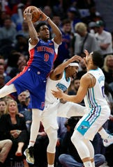 Langston Galloway grabs a rebound over Hornets guard Malik Monk, center, and forward Miles Bridges, right, during the second half Sunday.